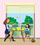 Young woman and her daughter have a breakfast. Stock Photo