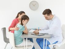 Young woman with her daughter having appointment. Young women with her daughter having appointment at child psychologist office stock images