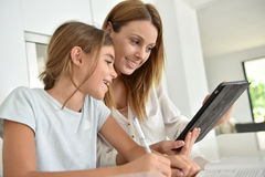 Young woman and her daughter using tablet Stock Photo