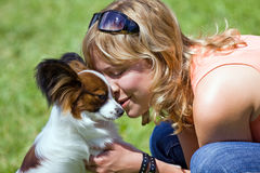 Young woman and her dog stock images