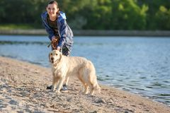 Young woman with her dog on beach. Pet care. Young woman with her dog together on beach. Pet care Stock Photography