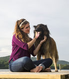 Young Woman with her Dog on a Dock Royalty Free Stock Photography