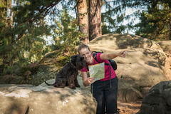 Young woman and her dog enjoy mountain hikes in summer Royalty Free Stock Photography
