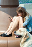 Young woman and her dog golden retriever in the park on a summer day Stock Image