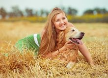 Young woman with her dog Stock Image