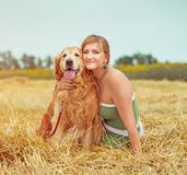 Young woman with her dog Royalty Free Stock Images