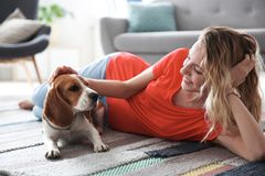 Young woman with her dog. At home Royalty Free Stock Image