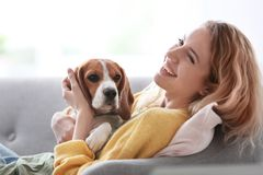Young woman with her dog. At home Royalty Free Stock Photography
