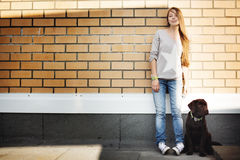 Young woman with her dog labrador retriever Royalty Free Stock Photo