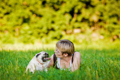 Young woman with her dog Royalty Free Stock Photos
