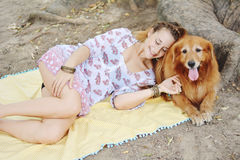 Young woman with her dog outdoors. Royalty Free Stock Photography