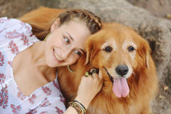 Young woman with her dog outdoors. Stock Photography
