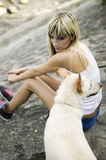 Young woman with her dog by a river Royalty Free Stock Photos