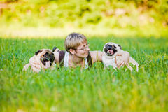 Young woman with her dogs Royalty Free Stock Image