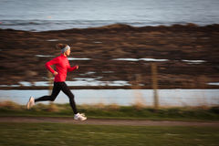 Young woman on her evening jog Stock Images