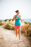 Young woman on her evening jog Stock Photography