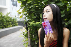 Young woman and her gift. Royalty Free Stock Images