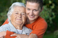 Young woman and her grandma royalty free stock photography