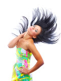 Young woman with her hair blowing and smiling, in Royalty Free Stock Images