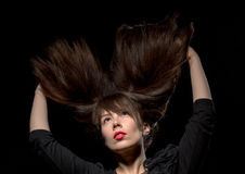 Young woman with her hair flying in the air Royalty Free Stock Image