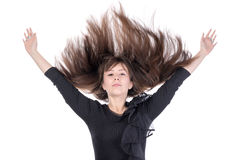 Young woman with her hair flying in the air Royalty Free Stock Photography