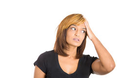 Young woman with her hand on head thinking how to correct the mistake she made Stock Photography