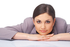 Young Woman With Her hands Under her Chin Stock Photography