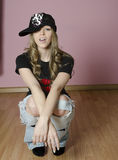 Hip hop girl. Young woman with her hat kicked Royalty Free Stock Images