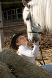 Young woman with her horse Royalty Free Stock Photo