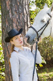 Young woman with her horse Stock Images