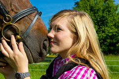Young woman and her horse Royalty Free Stock Images