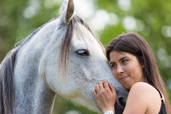 Young woman with her horse Stock Image