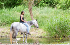 Young woman with her horse Royalty Free Stock Photography