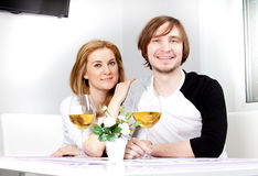 Young woman and her husband. Young women in home having meal and wine with her husband Royalty Free Stock Image