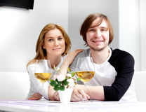 Young woman and her husband. Young women in home having meal and wine with her husband Stock Images