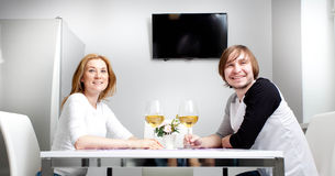 Young woman and her husband. Young women in home having wine with her husband Royalty Free Stock Photography