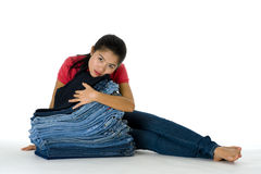 Young woman with her jeans collection Royalty Free Stock Images