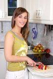 Young woman in her kitchen Stock Photos