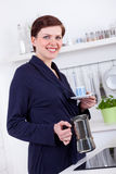 Woman in her kitchen preparing coffee with a moka pot Royalty Free Stock Photos