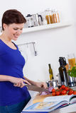 Woman in her kitchen preparing a pasta dish Royalty Free Stock Images