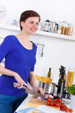Woman in her kitchen preparing a pasta dish Royalty Free Stock Photo