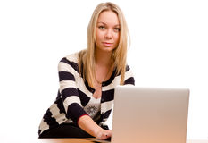 Young woman with her laptop Stock Image