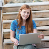 Young woman with her laptop Stock Photo