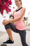 Young woman with her leg up stretching her leg royalty free stock photo