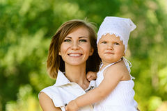 Young woman and her little daughter Royalty Free Stock Images
