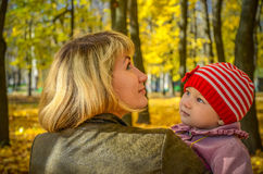 Young woman & her little daughter in the autumn park Stock Images