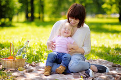 Young woman and her little son having a picnic Royalty Free Stock Photography