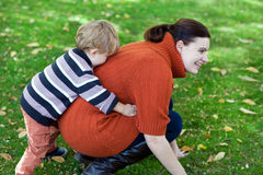 Young woman and her little toddler boy Stock Photo