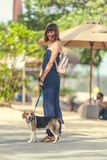 Young woman with her lovely beagle dog in the park of Bali island, Indonesia. Royalty Free Stock Photos