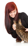 Young woman with her lovely grey cat Stock Photo